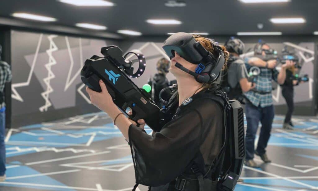 girl playing untethered VR arena experience